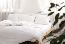 Comfortable Bed With Soft Pillows In Room Interior