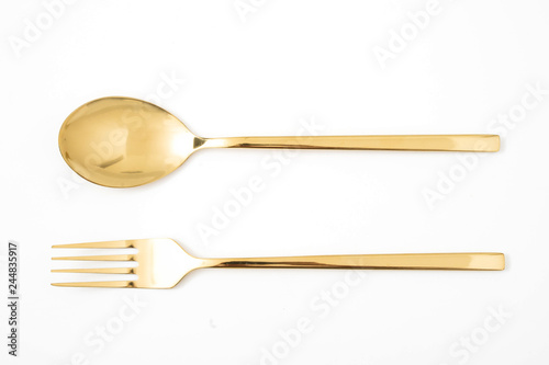 Cuadros en Lienzo golden spoon and fork isolated on a white