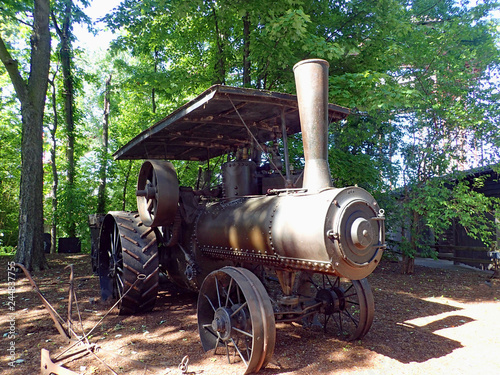An old copper colored turn of the 19th century steam engine