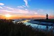canvas print picture - Leuchtturm in Wremen bei Bremerhaven im Sonnenuntergang, Weltnaturerbe Wattenmeer in Norddeutschland