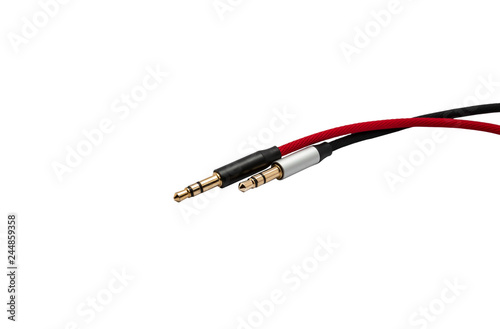 Photo Red and black aux audio cable isolated on white background