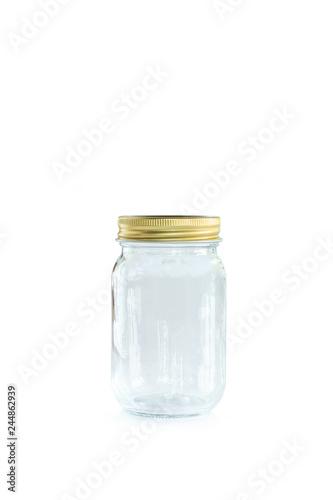 Fényképezés  Empty jar of golden cap is closing on a white backgrond.