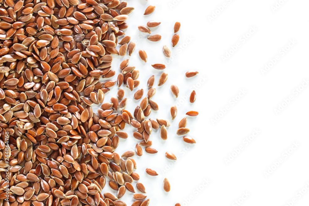 Fototapety, obrazy: Brown flax seed on white background.