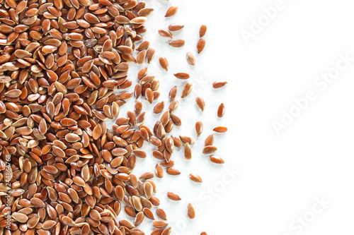 Brown flax seed on white background.