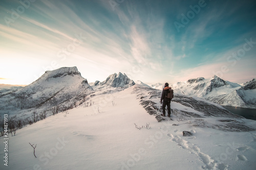 Fotografie, Obraz  Mountaineer standing on top of snowy mountain