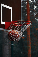The Ball In The Basketball Hoop