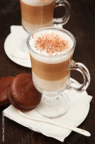 Valokuva Cappuccino with cinnamon. Cup of coffee on wooden background