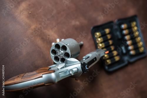 Fotografia  .44 magnum jacket soft point bullet on leather