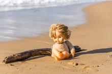 Cast Away Broken Doll Washed Up On A Beach