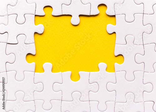 Fotografie, Obraz  Copy space of unfinished white jigsaw puzzle pieces