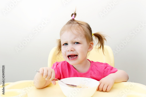 Valokuva  Crying little girl dont want to eat soup