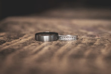 Silver Wedding Rings On Wooden Table