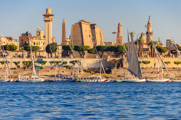 Luxor Temple is a large Ancient Egyptian temple complex on east bank of Nile river in Luxor (ancient Thebes). View from Nile river
