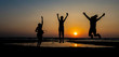 Happy friend people group celebrated jumping for good happy day on holiday concept, Person freedom together in summer and Sunrise light in the morning at beach . Silhouette