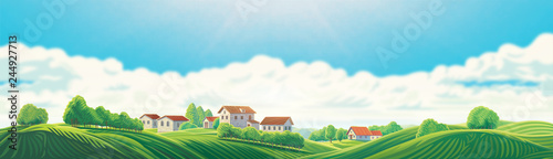 Foto  Rural panoramic landscape with a village and hills on a background of clouds