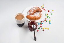 Cup Of Coffee And Donuts On Wh...