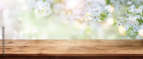 Fotografiet Spring blossoms with wooden table