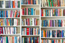 Blurred Image Of Colorful Bookshelf In Secondhand Shop.