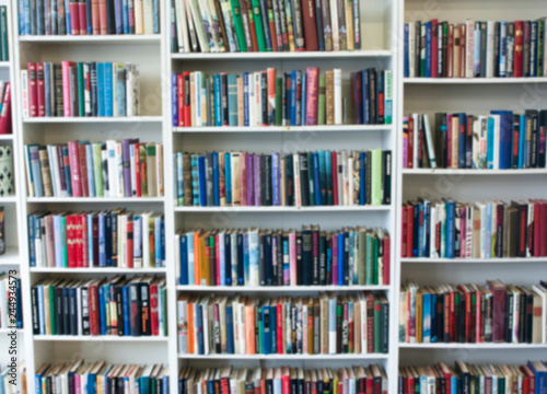 Blurred image of colorful bookshelf In secondhand shop. Wallpaper Mural