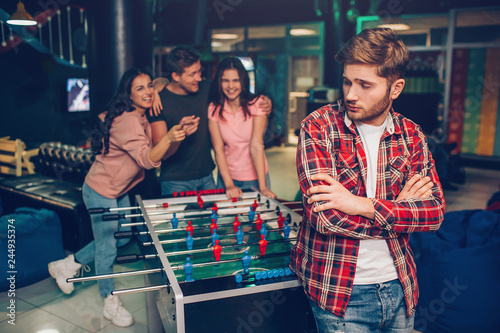 Valokuva  Upset young man stand in front in playing room