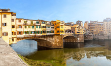 Famous Landmark Ponte Vecchio Bridge Over Arno River In Florence, Italy