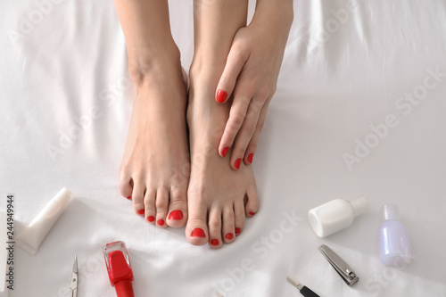 Fotobehang Pedicure Legs of young woman with fresh pedicure after visiting beauty salon