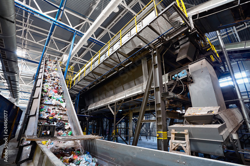 Fotografiet  Wide angle view at recycling plant conveyor belt transports garbage inside drum