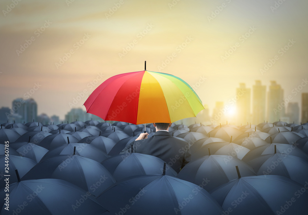 Fototapety, obrazy: businessman with colorful rainbow umbrella among others, unique different concept