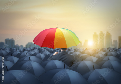 businessman with colorful rainbow umbrella among others, unique different concep Wallpaper Mural
