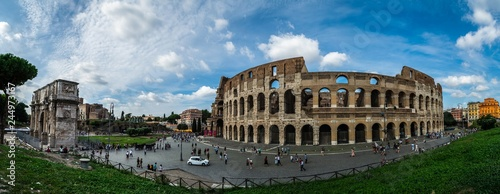 Fényképezés  panoramic view on Colloseum and Arch of Constantine with los of tourists during