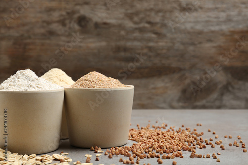 Composition with different types of flour on table. Space for text