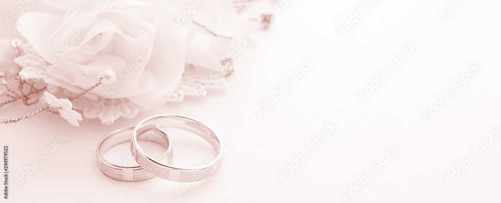 Fototapety, obrazy: Wedding rings on wedding card on a white background, border design panoramic banner, toning color living coral