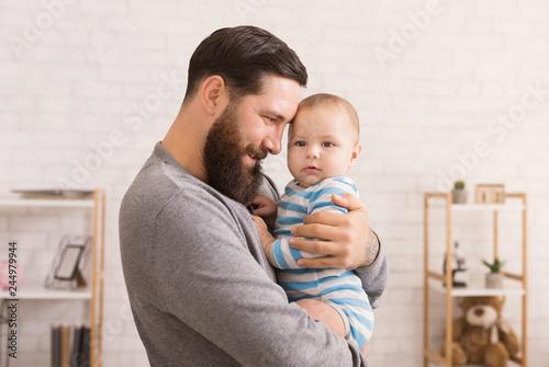 Obraz Loving father embracing his cute baby son - fototapety do salonu
