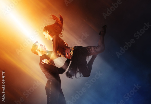 Pair of dancers dancing ballroom - 244981731