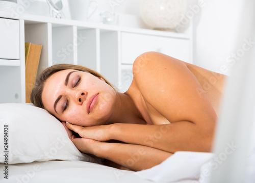 Foto op Canvas Akt Woman sleeping in bed