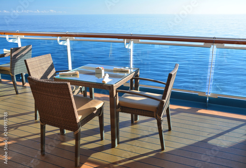 Restaurant tables on the open deck of cruise ship.