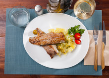 Delicious Fried Mackerel Fillets With Mashed Potatoes, Olives And Tomatoes
