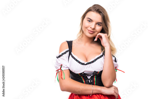 Portrait of a gorgeous sexyblonde haired woman in traditional Bavarian dress smiling to the camera isolated on white background Poster Mural XXL