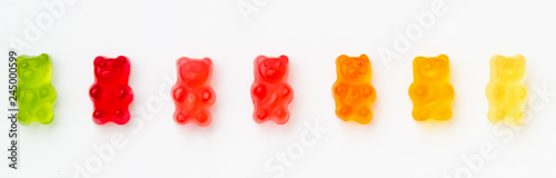 Fotomural  Colorful jelly candy gummy bears on white background
