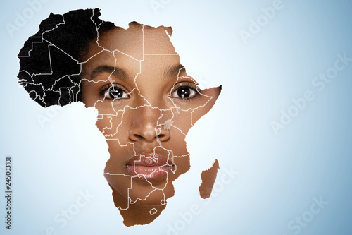 fototapeta na ścianę Face of African woman inside the map of Africa
