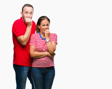 Middle Age Hispanic Couple In Love Over Isolated Background Looking Stressed And Nervous With Hands On Mouth Biting Nails. Anxiety Problem.
