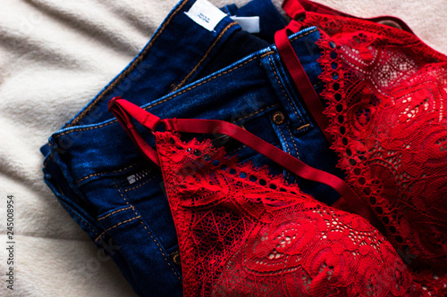 6841ed003603 Woman's sexual red lingerie and jeans on white background top view. Copy  space. Beauty