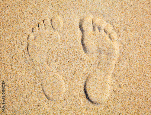Cuadros en Lienzo Two Footprints in sand at the Beach
