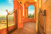 Entrance Gate Between The Portico And The Sanctuary Of San Luca. Famous Place Of Marian Worship On The Colle Della Guardia In Bologna, Emilia Romagna, Italy.