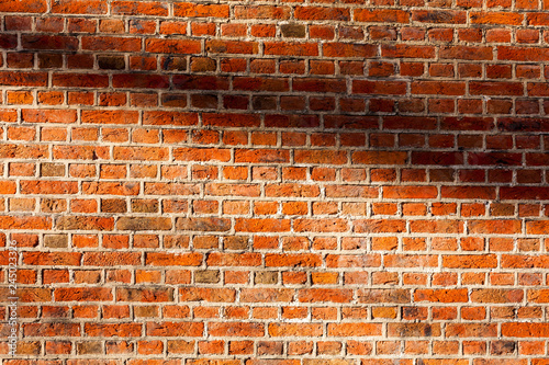 Photo sur Toile Brick wall Od red brick wall texture background. bricked wall of orange color, wide vintage style.