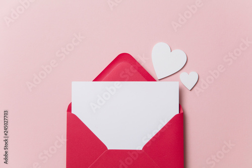 Fototapeta Love letter. white card with red paper envelope mock up