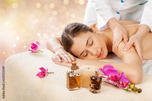 Fototapety, obrazy: Beautiful young woman relaxing with massage at beauty spa