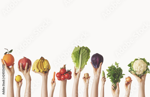 Fotografía  Hands holding different vegetables on isolated background