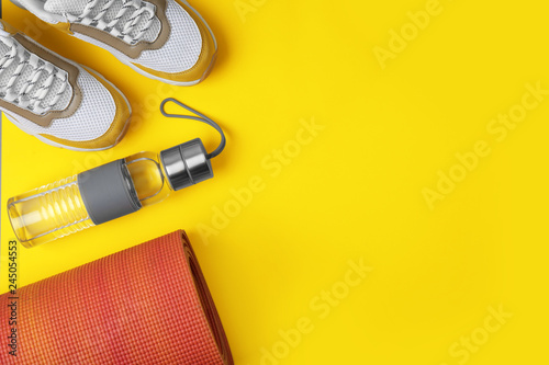 Flat lay composition of sport equipment on color background. Space for text