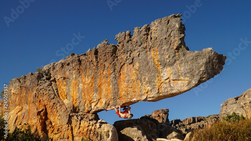 Rock climber on the Rhino boulder in Rocklands near Cape Town, South Africa Canvas Print